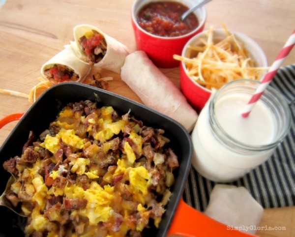 Skillet Breakfast Burritos made with sausage, bacon, eggs, cheese and with your favorite salsa.  Wrapped up in a warm tortilla!