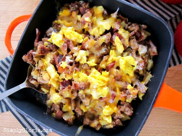 Skillet Breakfast Burritos with bacon, sausage, potatoes and eggs topped with cheese.