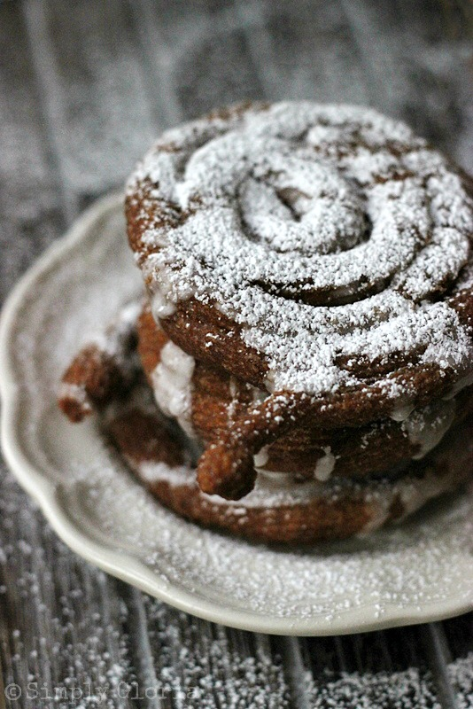 Mini Pumpkin Funnel Cakes with Cinnamon Glaze and topped with a dusting of powdered sugar by SimplyGloria.com