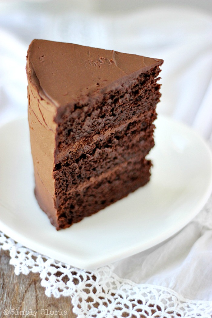 Dark Chocolate Cake with Whipped Ganache Frosting by SimplyGloria.com #cake #fudgy