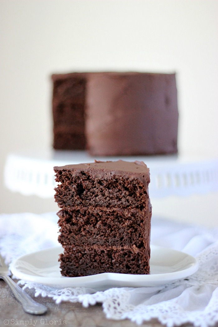 Dark Chocolate Cake with Whipped Ganache Frosting by SimplyGloria.com #chocolate #cake