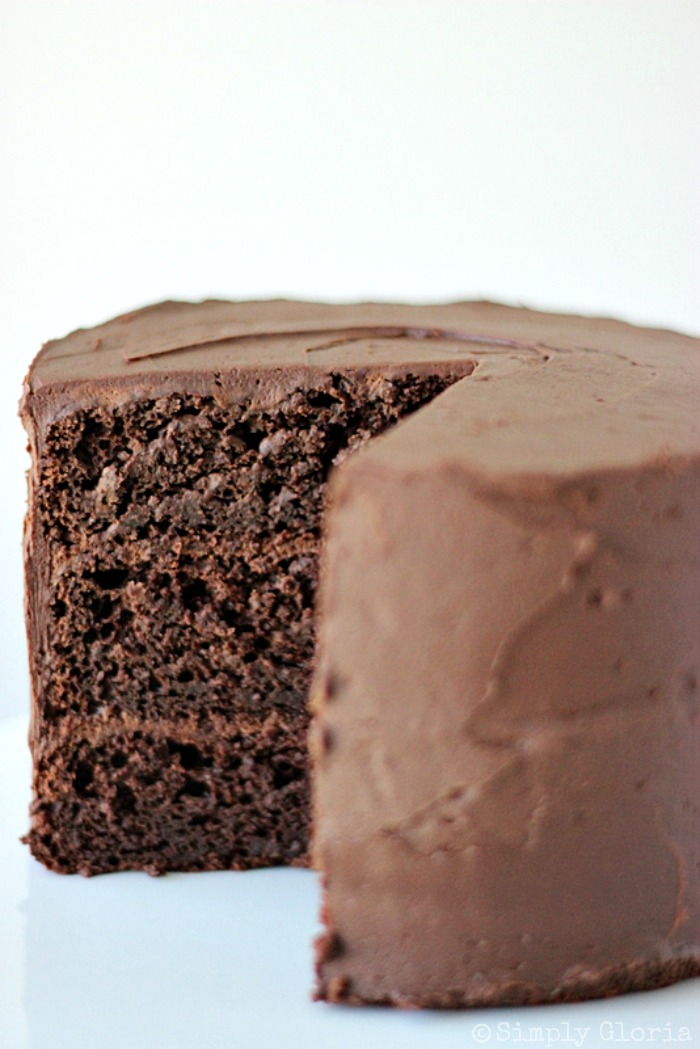 Dark Chocolate Cake with Whipped Ganache Frosting by SimplyGloria.com #chocolate #ganache