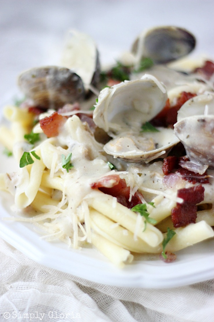 Peppered Bacon Clam Sauce poured over a bed of pasta! SimplyGloria.com #clam #bacon