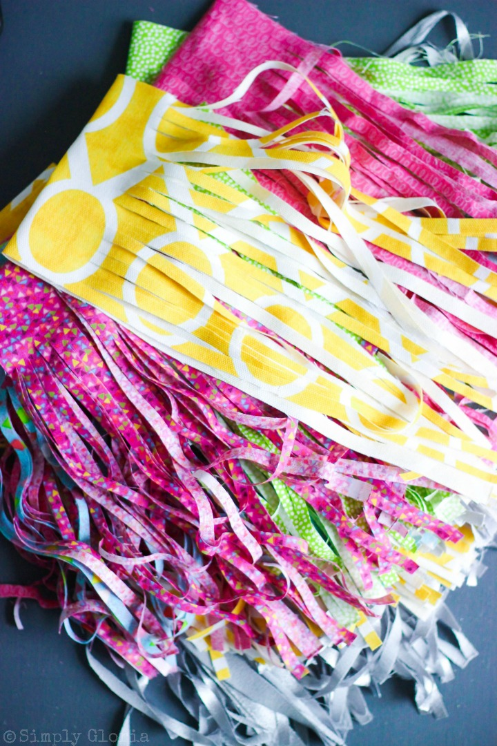 Making a No-Sew Fabric Tassel Garland is simple and fun with your favorite fabric! #tutorial i